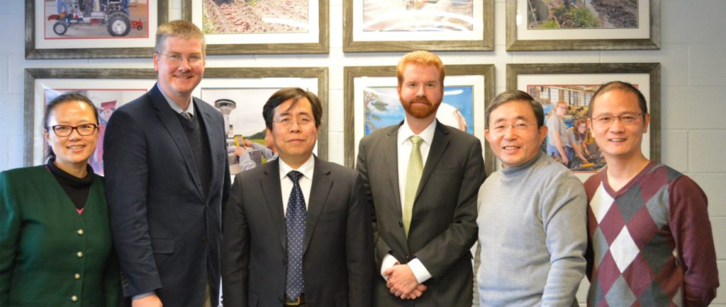 Professor Yang of Zhejiang University in China visiting with a group of professors at NC State.