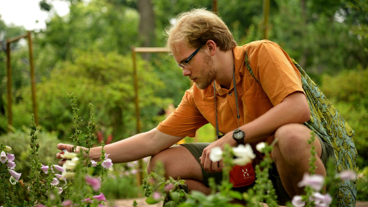 CALS student gets a closer look at plants in the Humble Administrator's Garden in Suzhou.