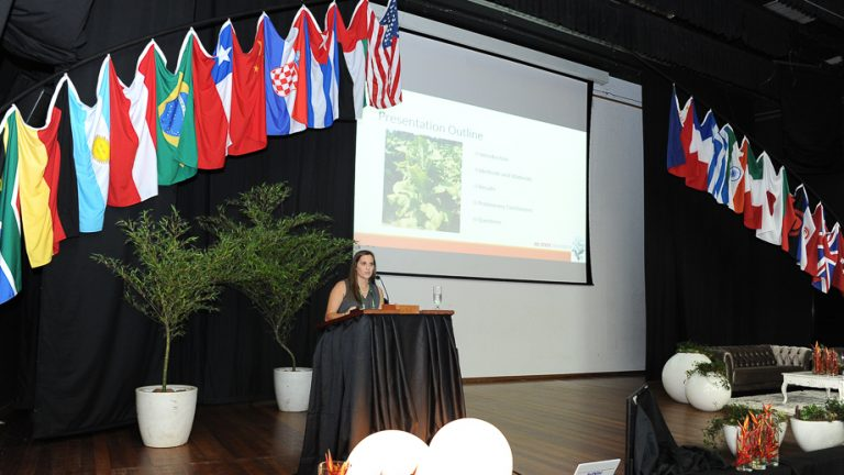 Cara Pace speaking at a conference.