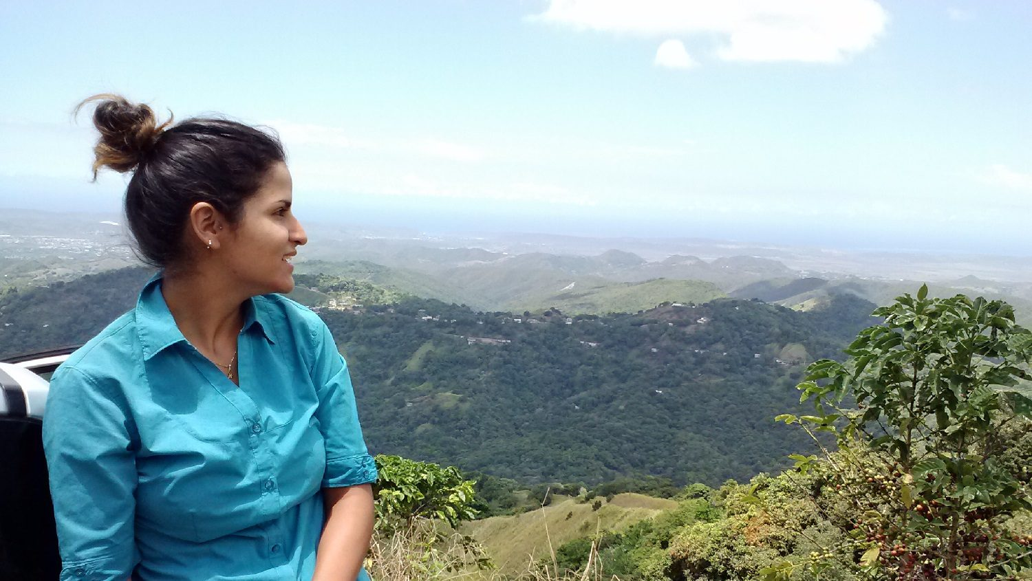 Sara Prado looking over the hillside of coffee plantations, in Maricao, Puerto Rico