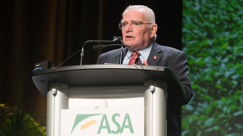 Man at an podium with ASA sign