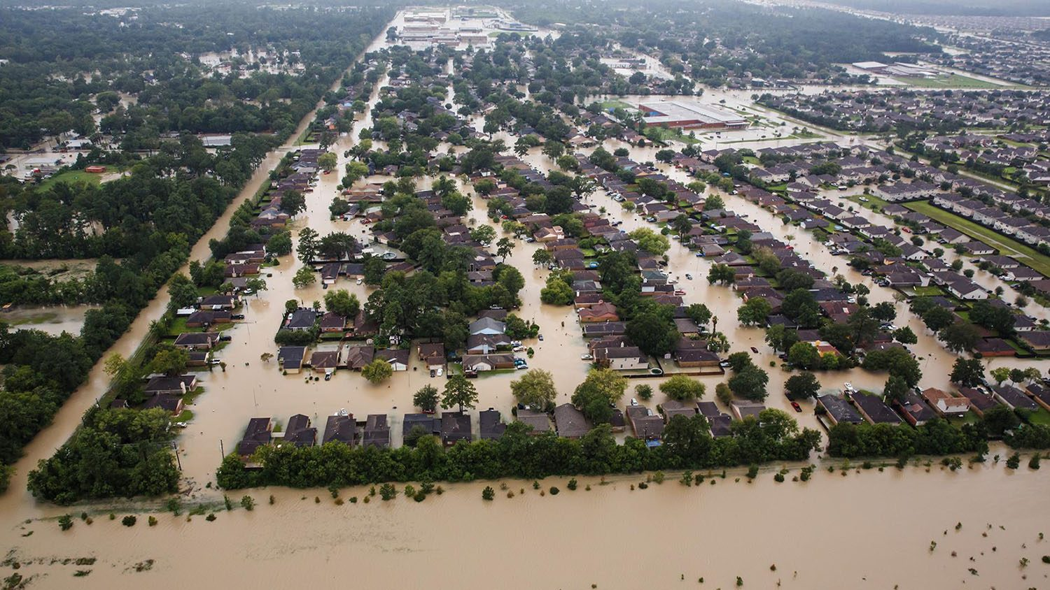 Aerial view of flooded residential area with