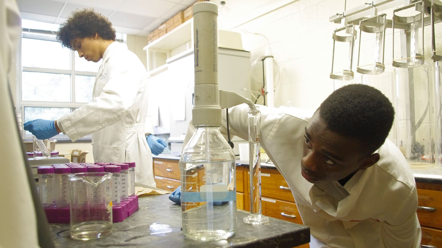 Two male high schools students working in a lab