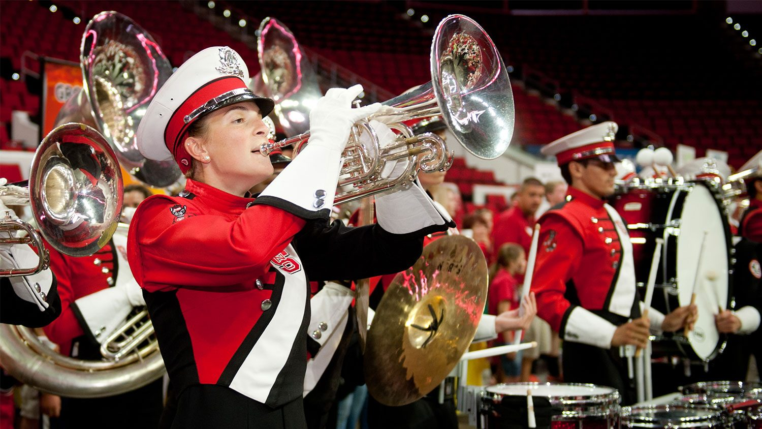 Female Marching Band member playing the tuba.