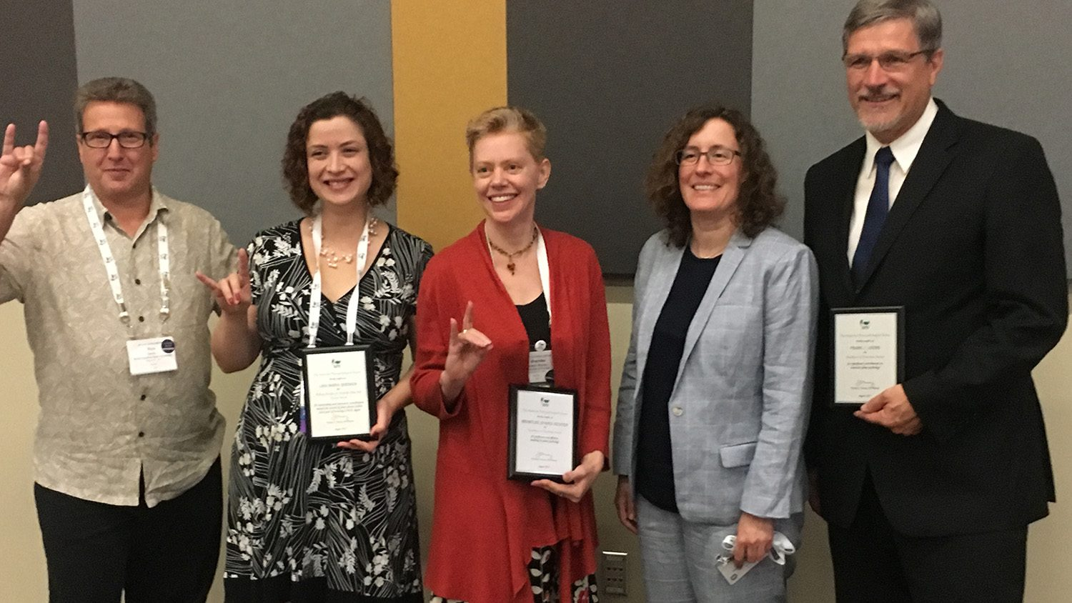 Photograph of the APS award winners and department head.