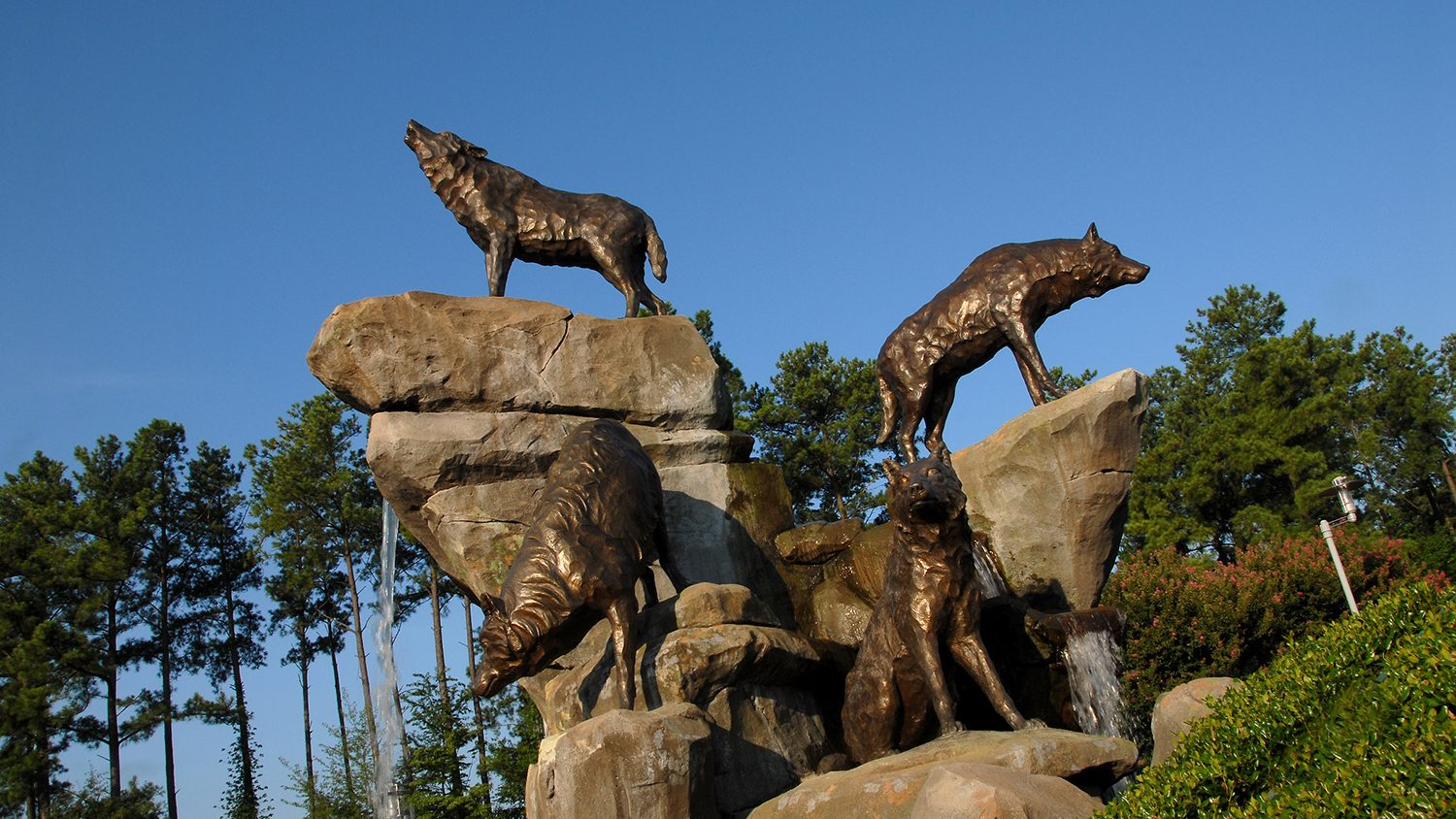 Statues of wolves and rocks.