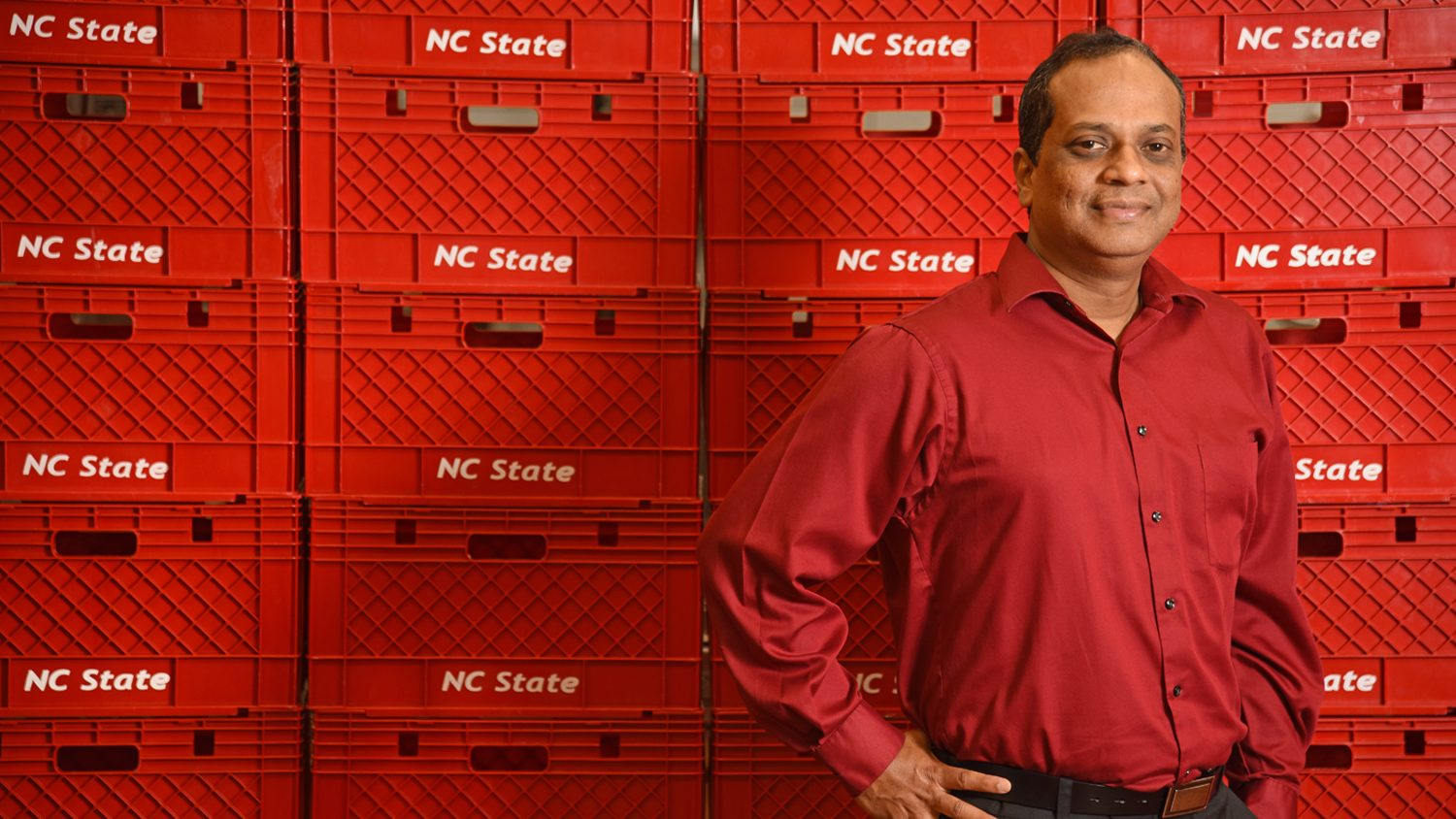 FBNS Department Head K.P. Sandeep standing in front of NC State milk crates