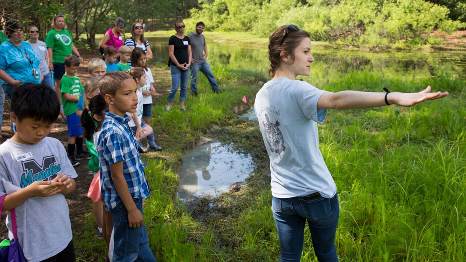 BAE assistant professor Natalie Nelson out in the field with students