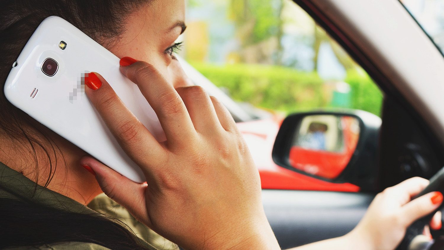 a driver on the phone while driving.
