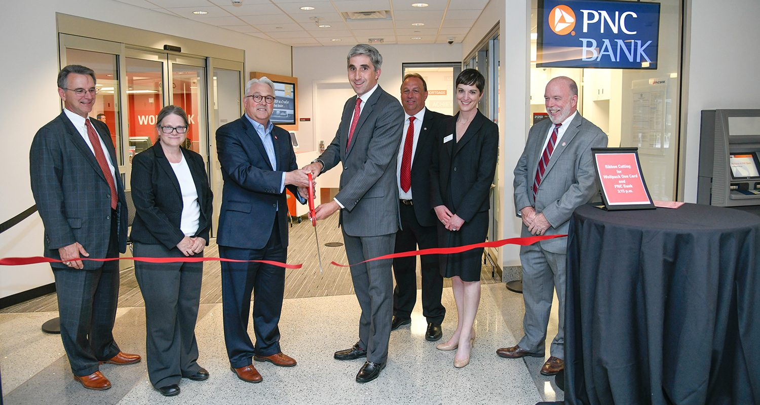 From left, PNC Vice President Jim Redilla, NC State Treasurer Mary Peloquin-Dodd, Chancellor Randy Woodson, PNC Regional President Jim Hansen, Randy Lait, senior director of hospitality services at NC State, Dawn Doherty of PNC and Tim Hogan, operations director of university student centers.