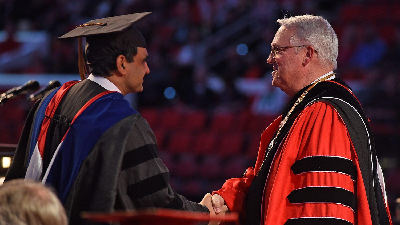 Chancellor Randy Woodson congratulates a doctoral grad