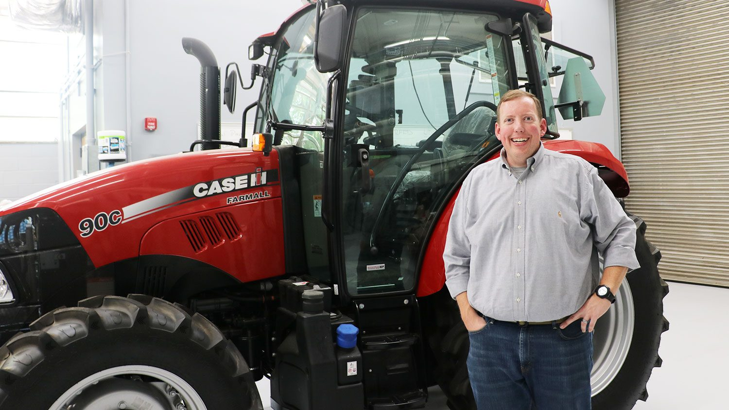 Man standing in front of tractor