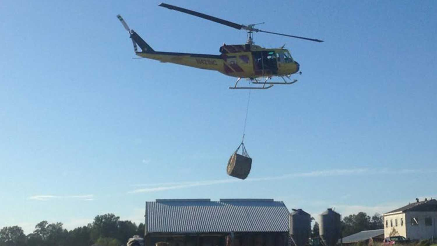 Helicopter droping food during crisis