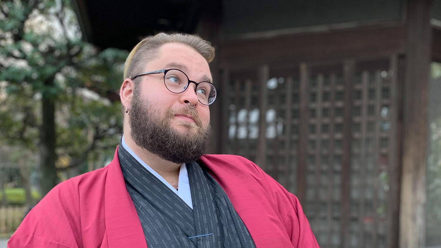 White male in red and black jacket