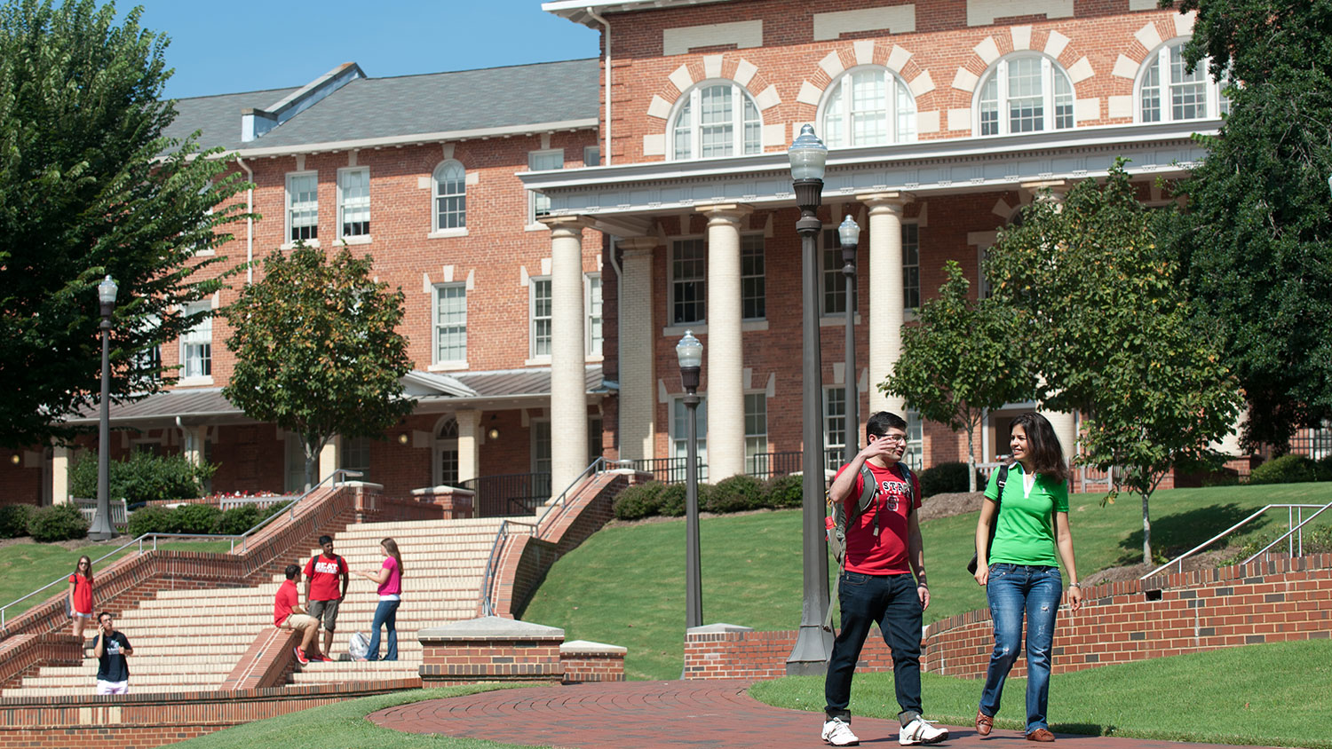 Students walking on NC State's campus near the 1911 Building
