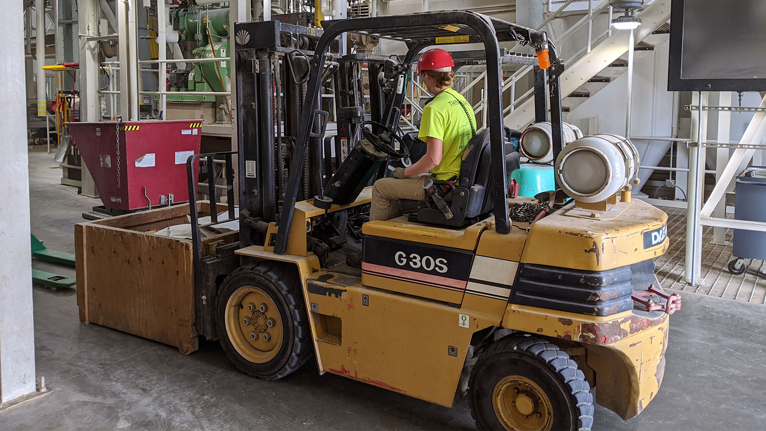 Person driving a forklift