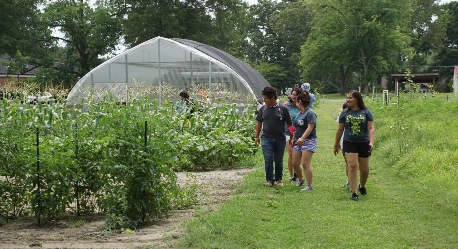 Group of latinx students on a small farm