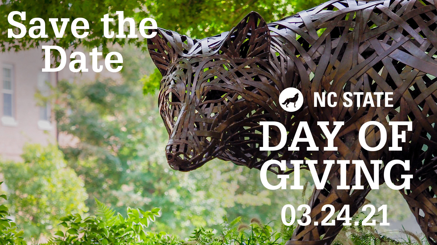 Save the Date for NC State Day of Giving 3.24.2021 text over of closeup of wolf sculpture in Stafford Commons