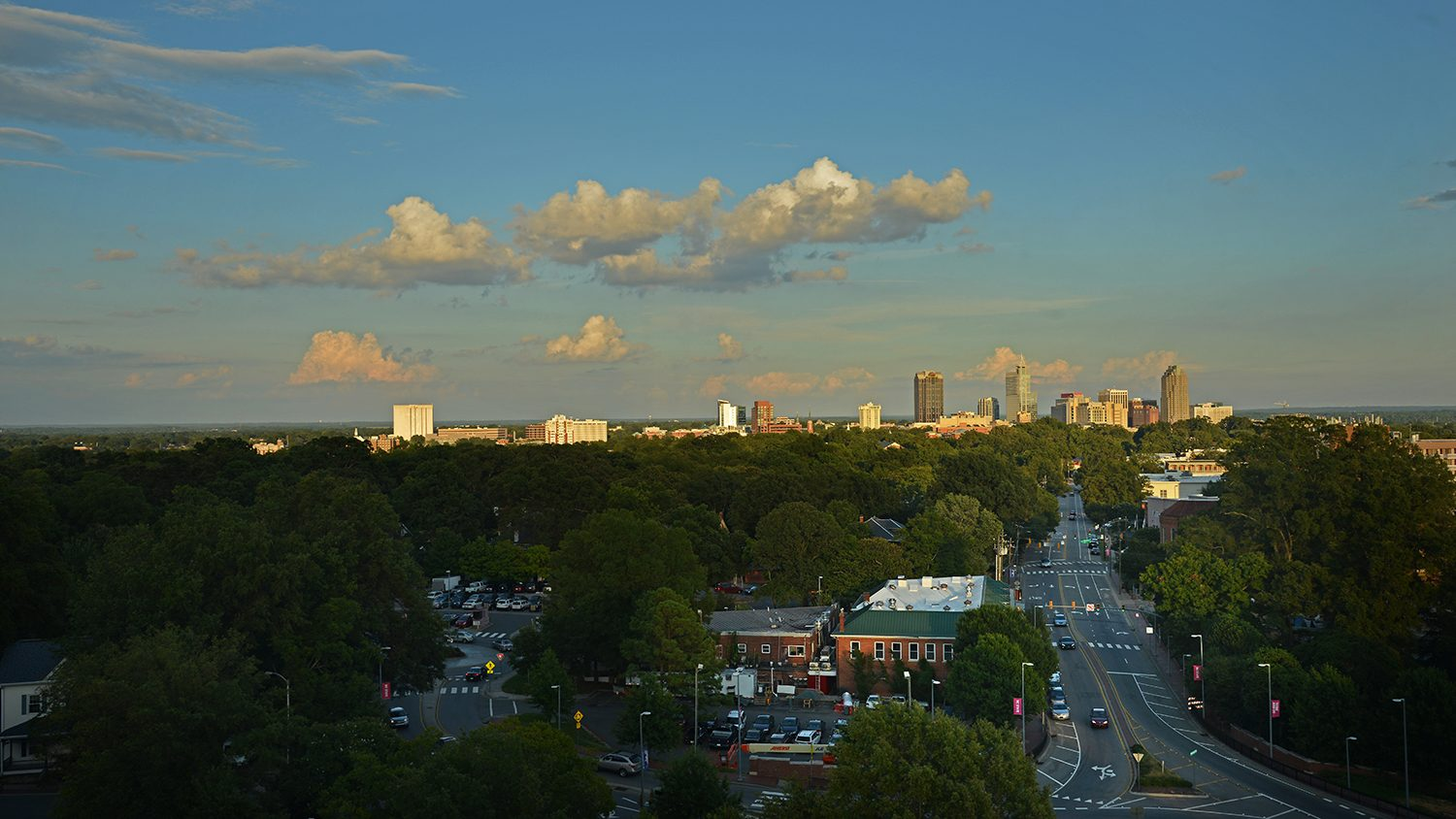 Photo of late afternoon sun in downtown Raleigh skyline.