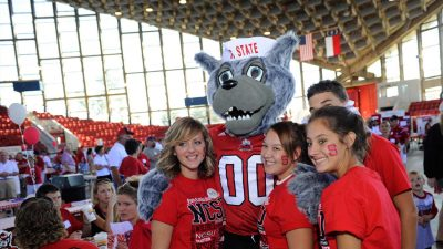 Students with Wuffie at CALS tailgate.