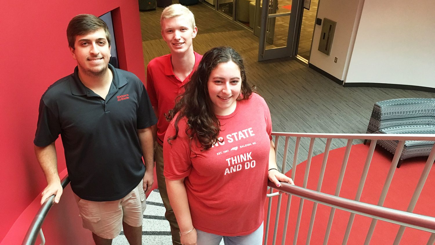 CALS students Harrison Walker, Luke Stancil and Victoria Pender standing on steps