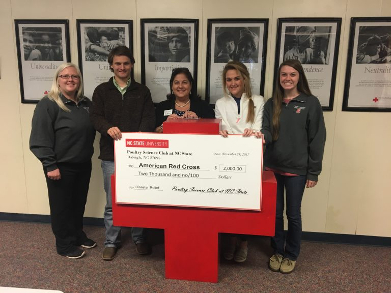 Poultry Science Club with large check