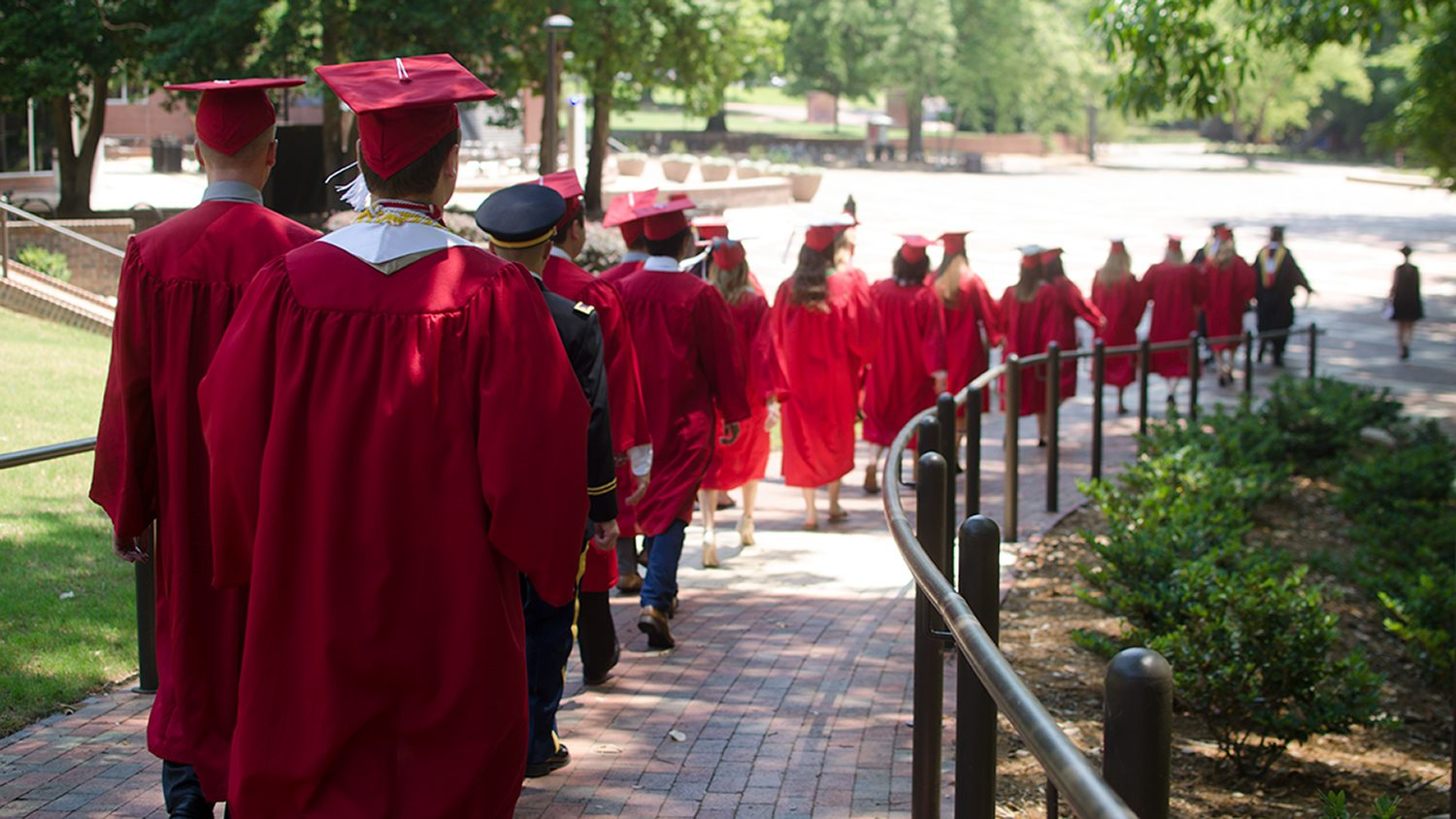 Spring 2018 graduates walking down brickyard ramp