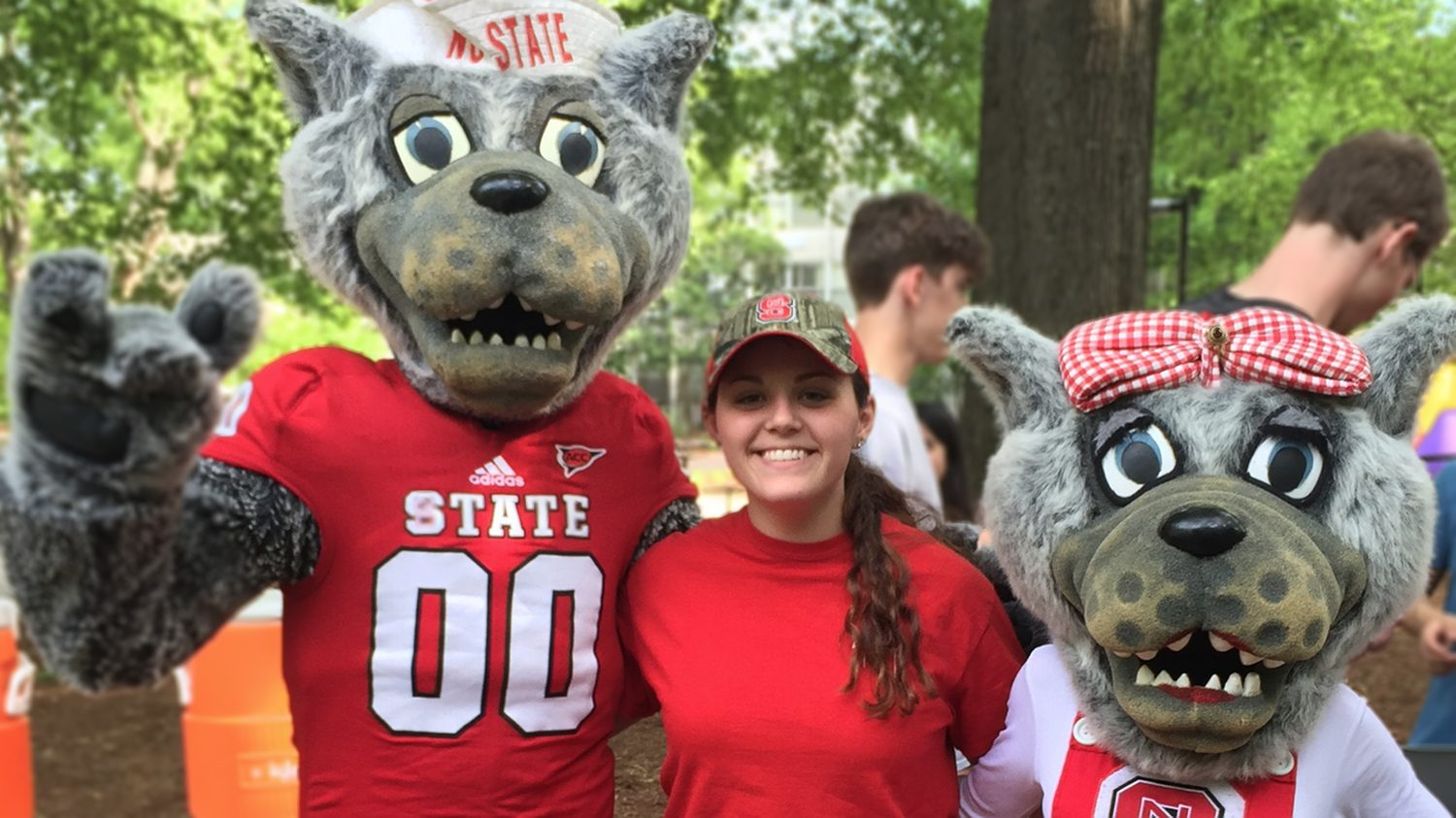 Brittany Wall with Mr. and Mrs. Wuf (NC State mascots)