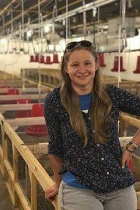 Kelly Brannon in a hen house