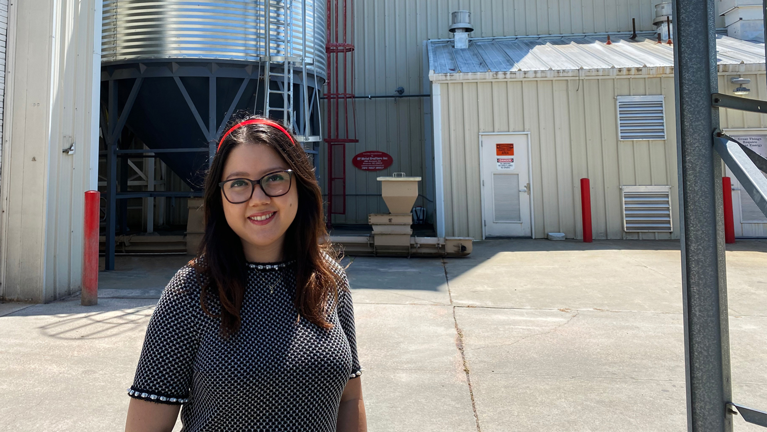 Andrea Rubio in front of the NC State Feed Mill Education Unit