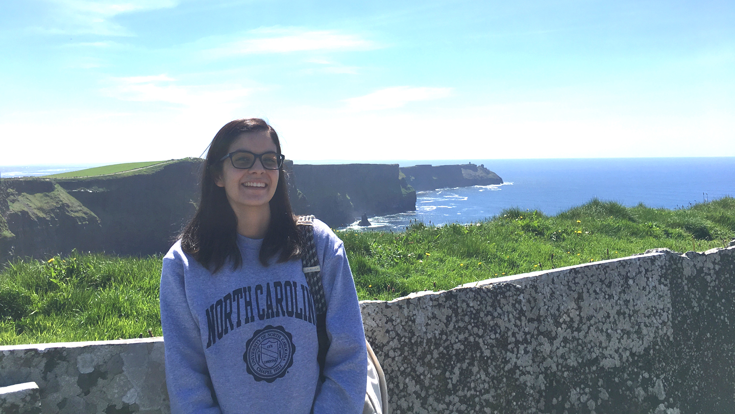 Emily Miramontes outside with cliffs and sea behind her