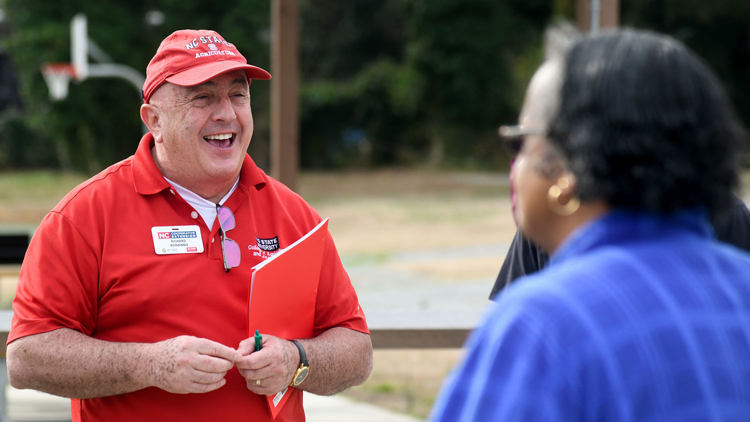 Rich Bonanno speaking to a person at an outdoor event