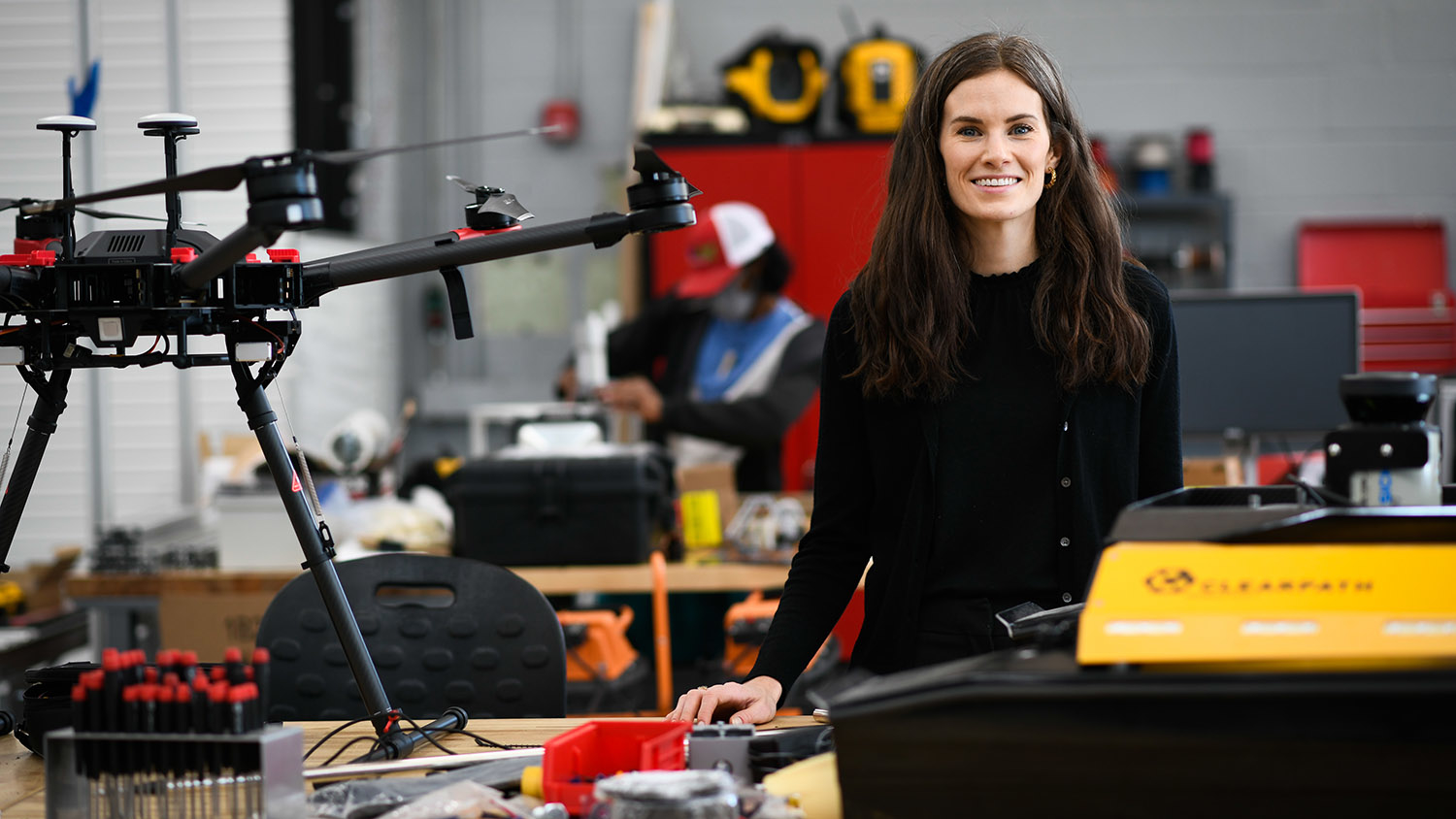 Woman with drones and robots.