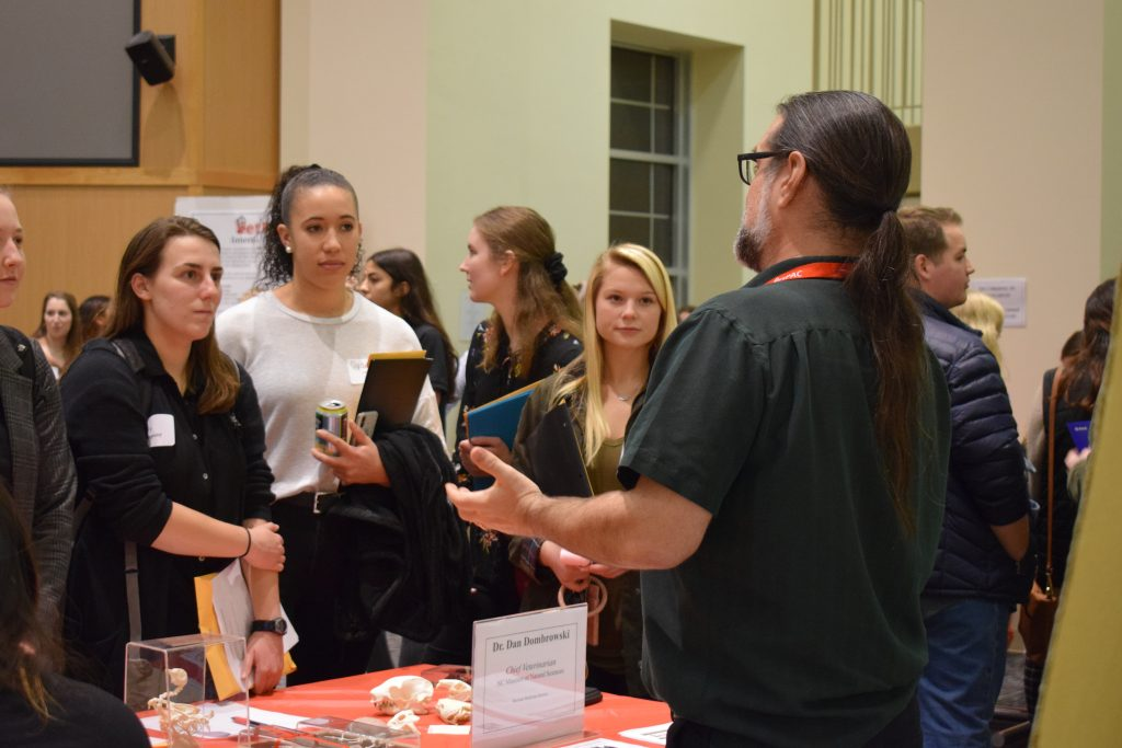 Dr. Dan Dombrowksi speaking to students at a networking event