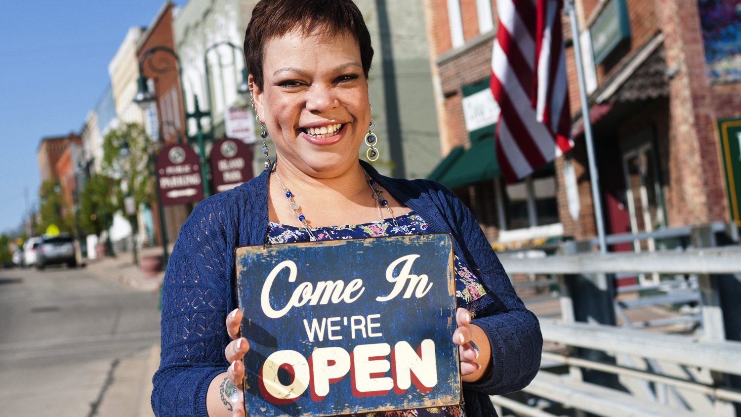 Small town female shop owner open for business