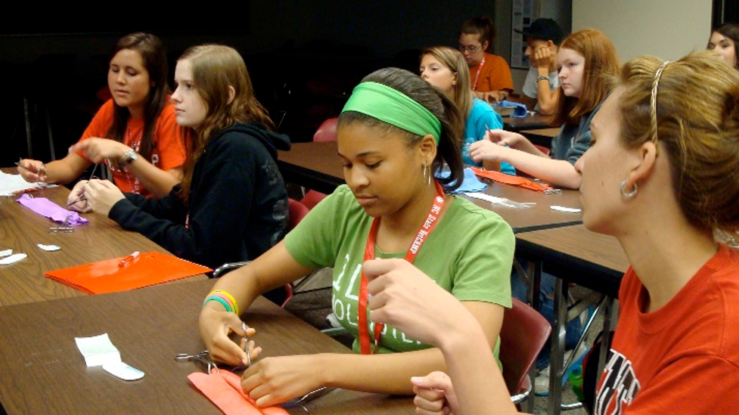 Campers get acquainted with the tools needed for stitching up sutures.