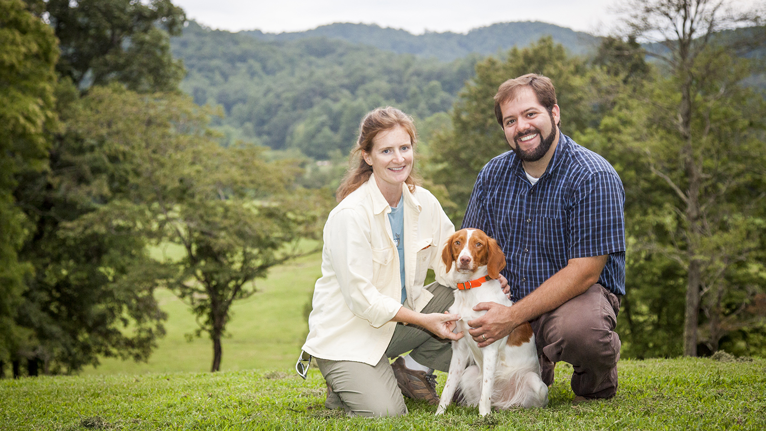 Brittany Whitmire and Andy von Canon with their dog on their farm.