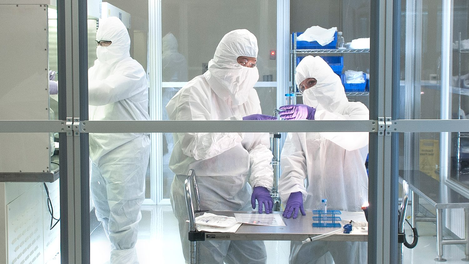 Researchers work in clean room