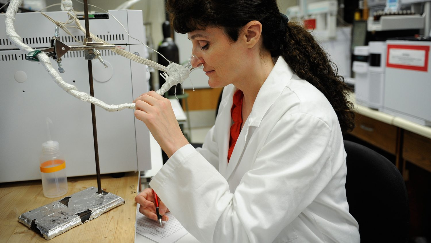 A female researcher conducting experiments in a lab.