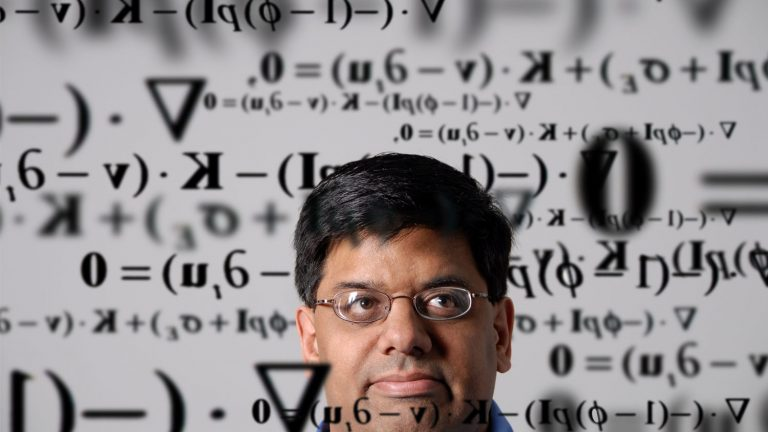 Researcher in front of math equations