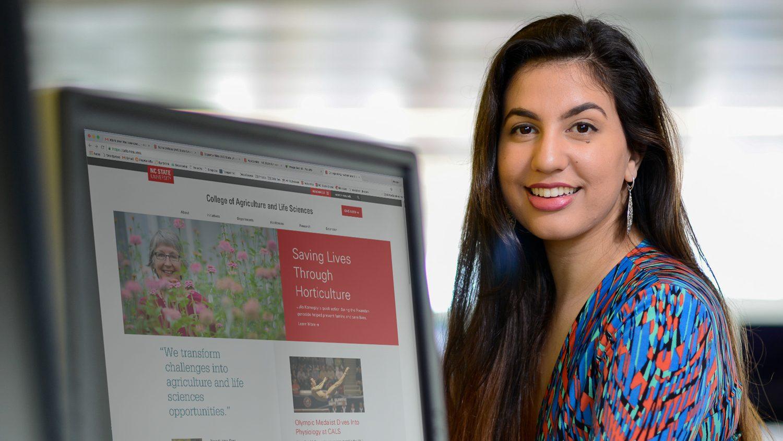 Student in front of CALS website