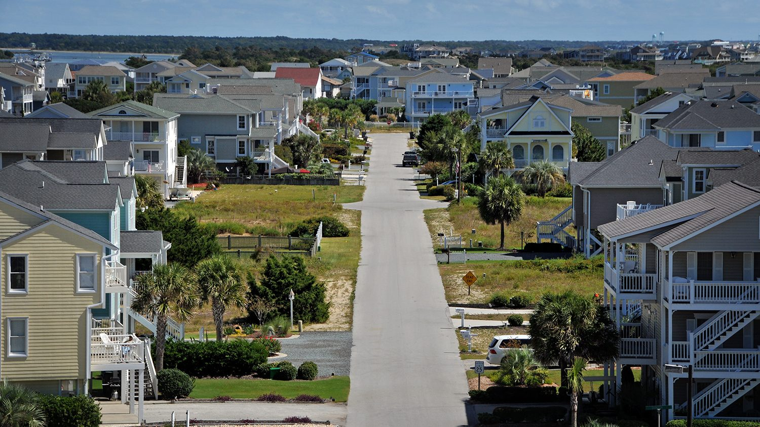 Aerial view of cottages and beach homes at Holden Beach