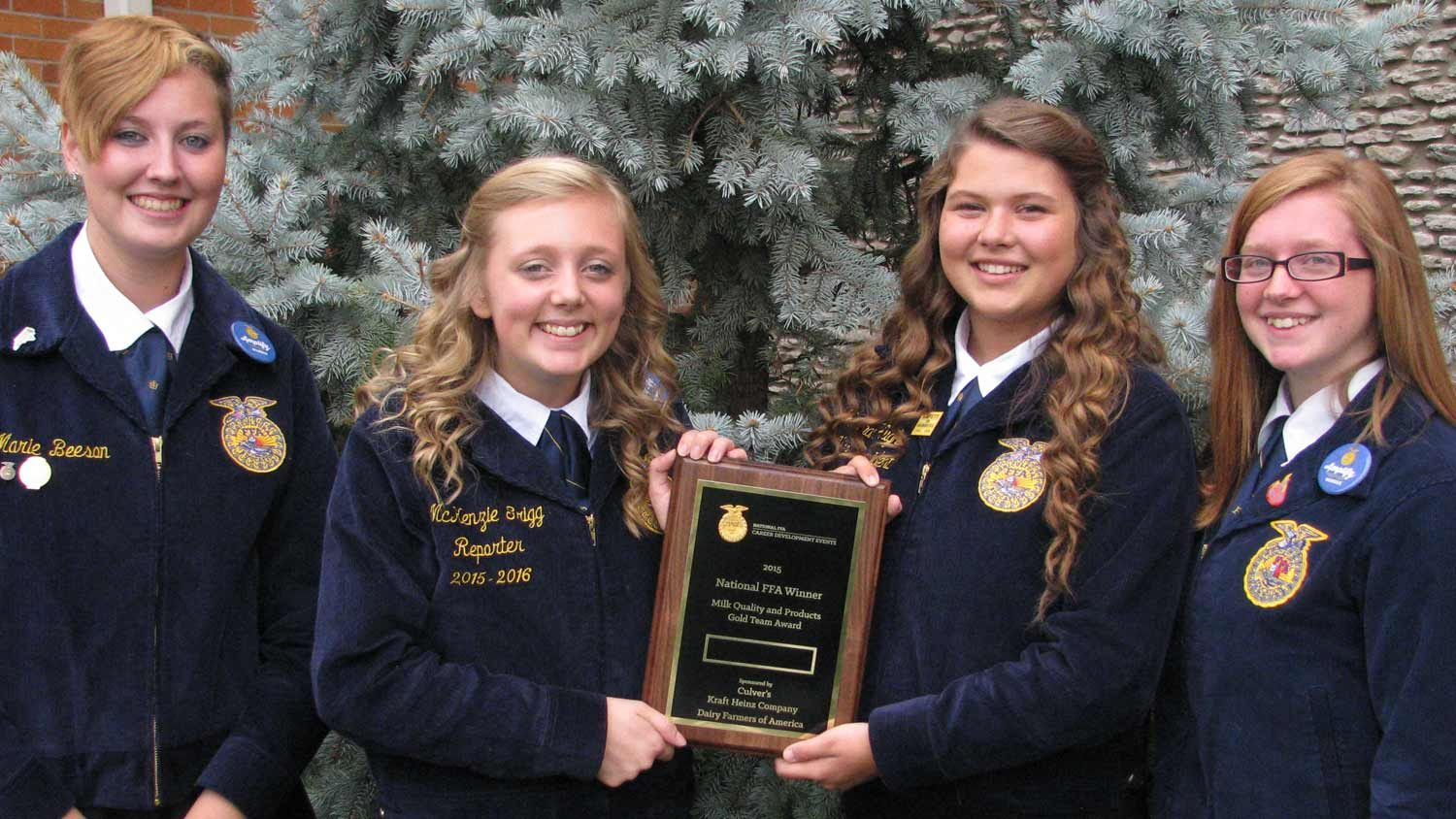 FFA members holding a plaque