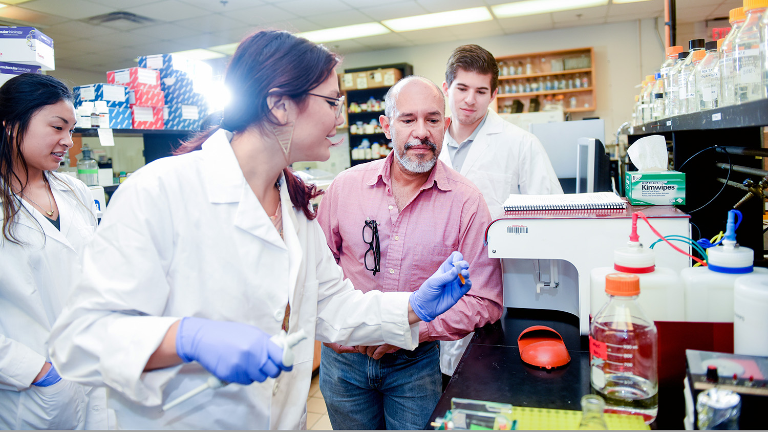 Group examines sample in lab