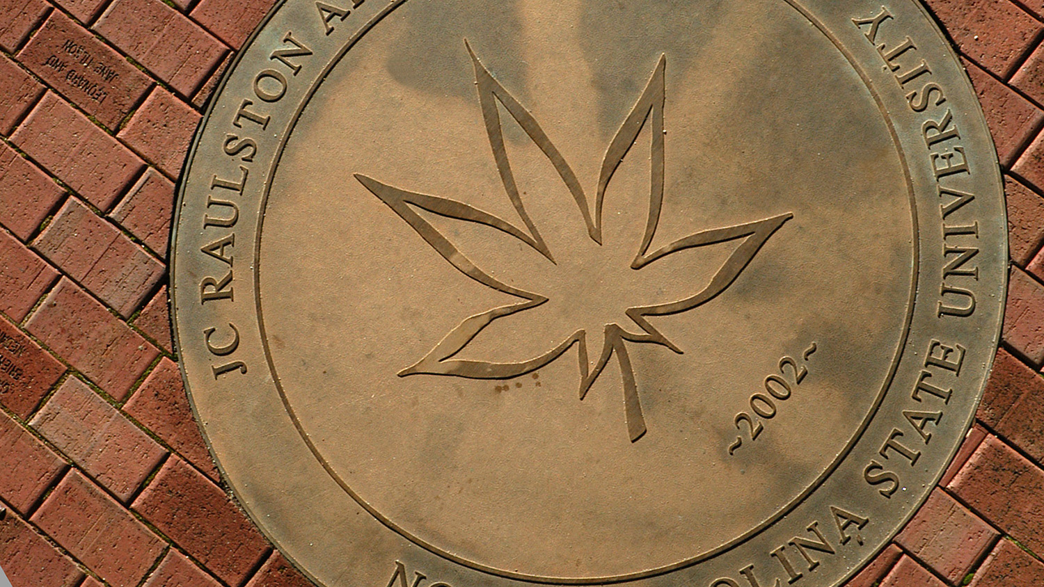 JC Raulston Arboretum seal by the Ruby McSwain building.