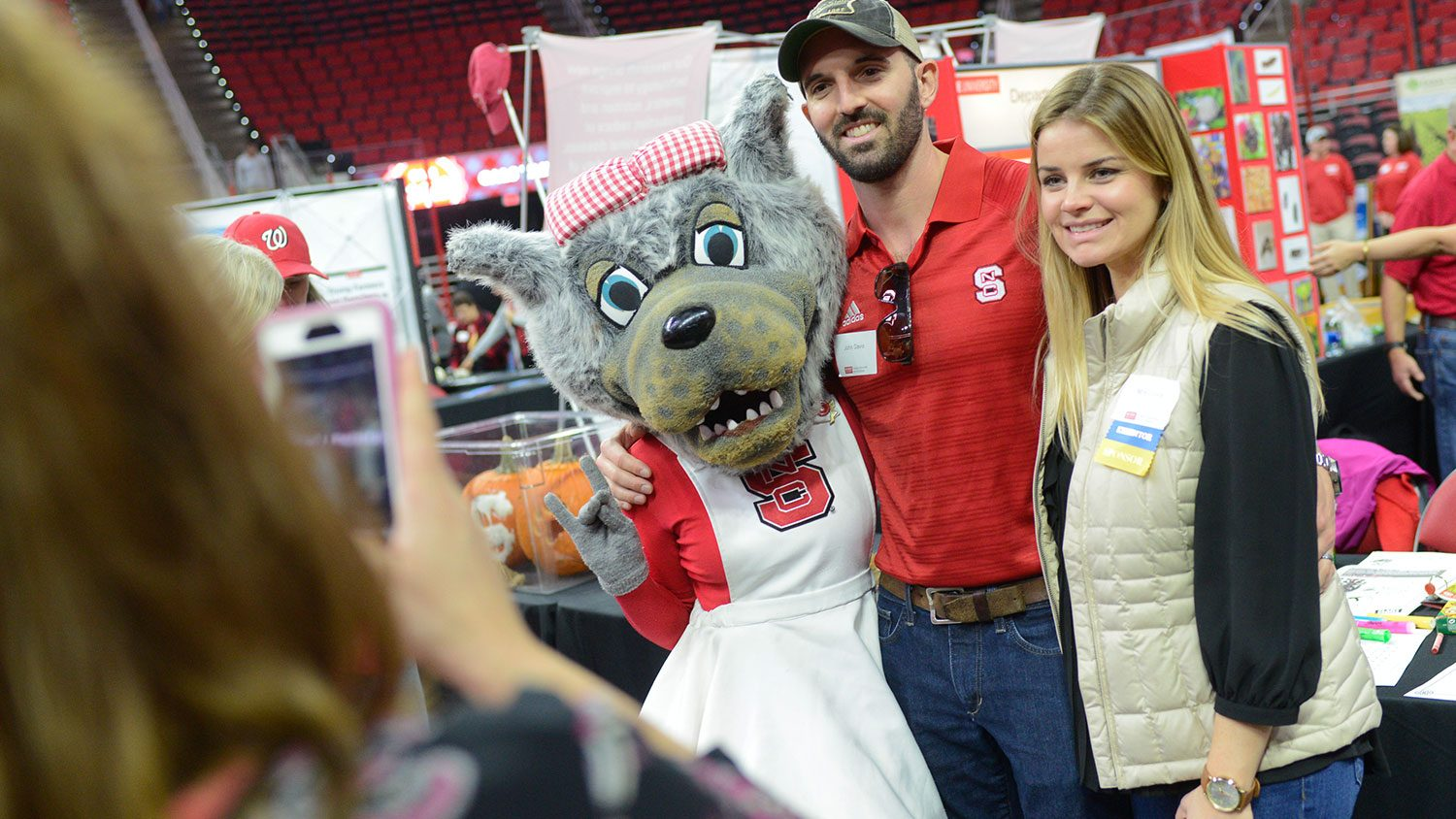 Mascot with woman and man