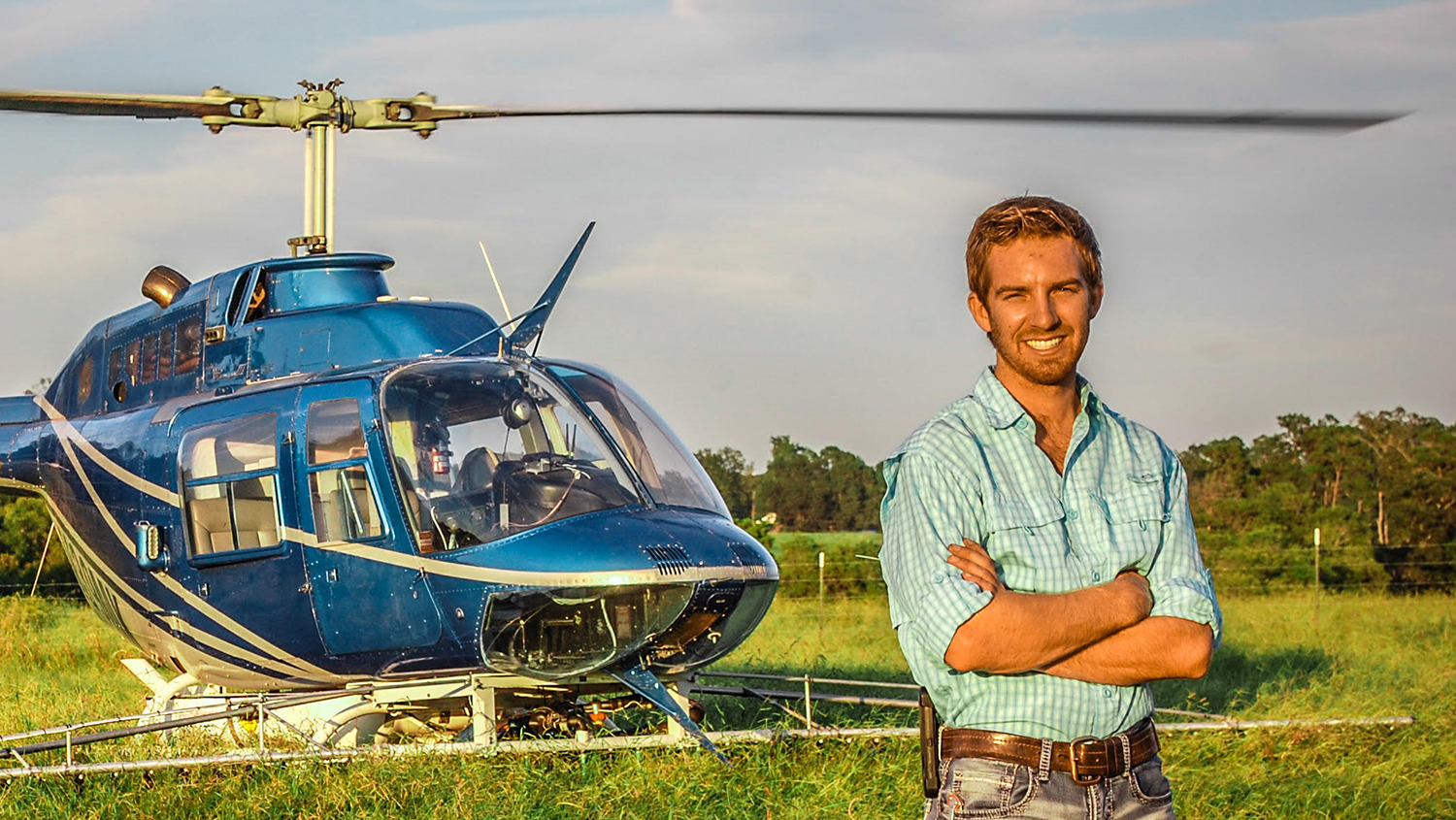 Jacob Tarlton in a field with his helicopter.