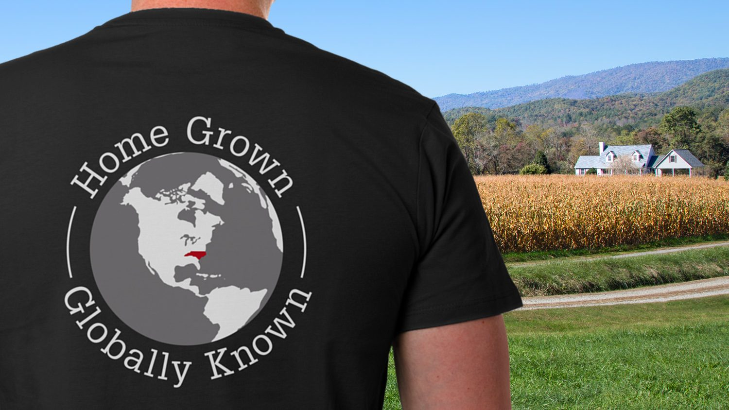 """Man wearing CALS Tailgate T-shirt with slogan """"Home Grown, Globally Known"""""""