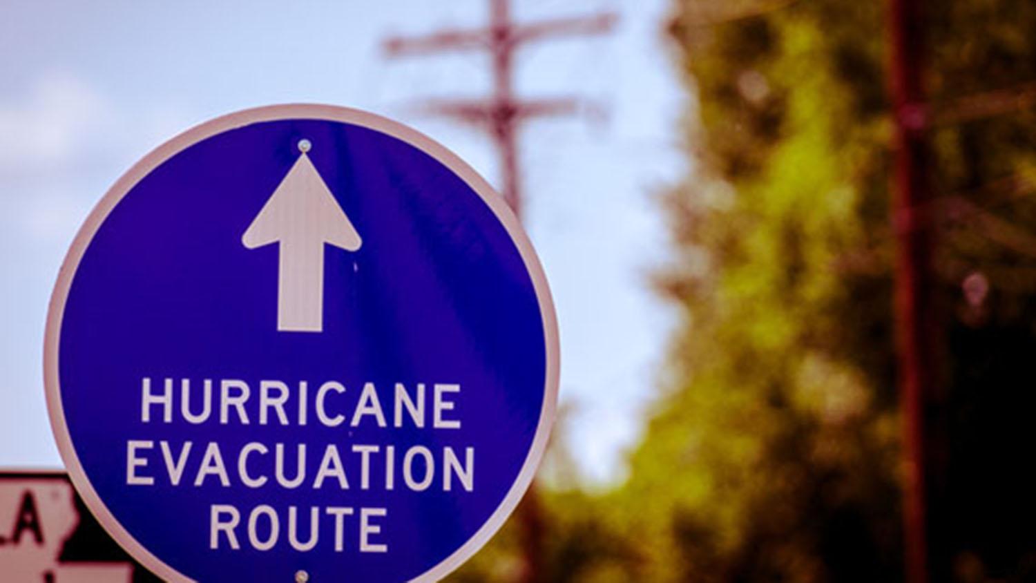 Road sign pointing to hurricane evacuation route