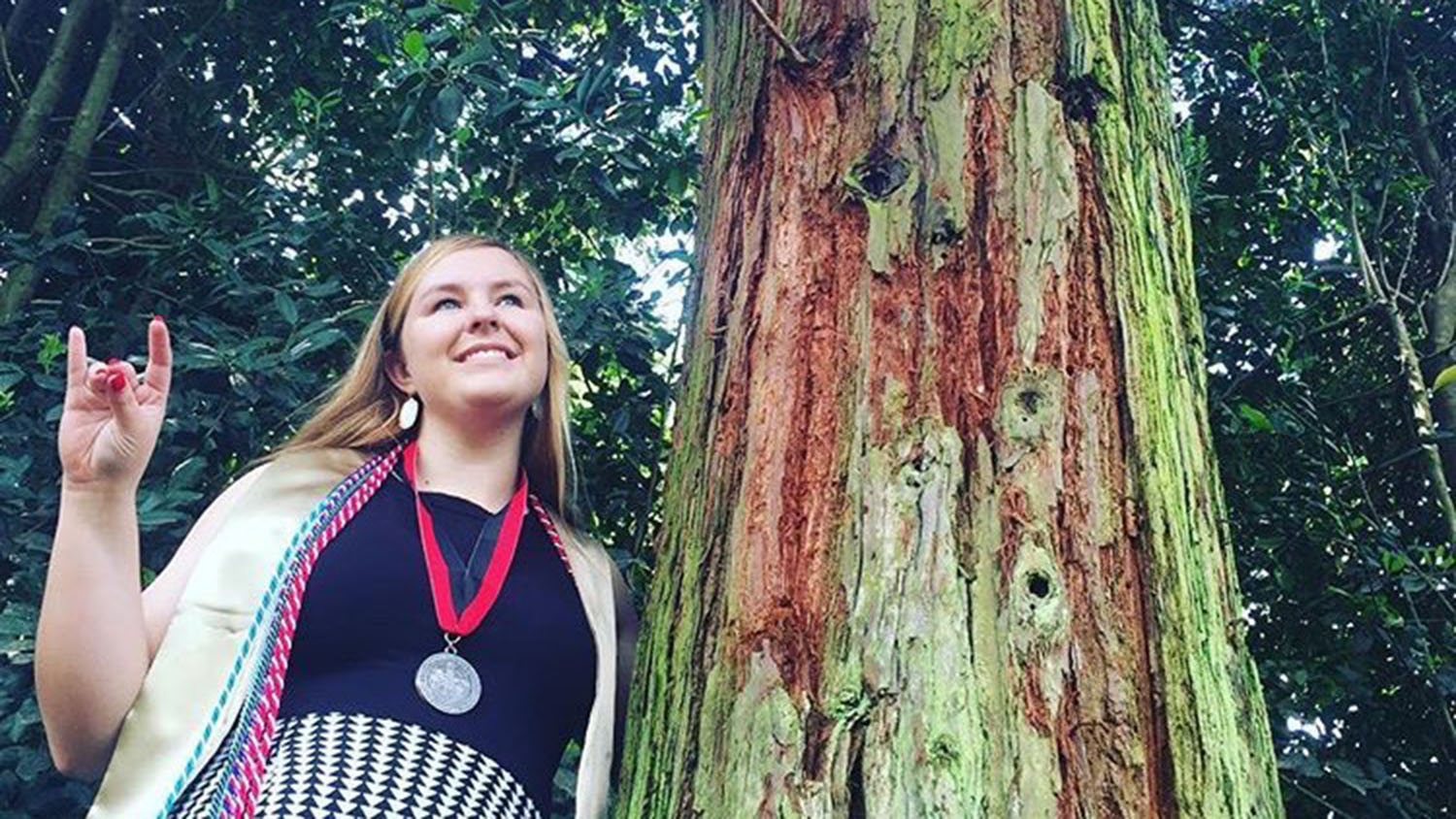 Britanny Bell poses with tree